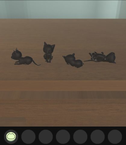 双眼鏡をのぞき込んで見えた猫の向きに合わせて、猫の置物の向きを変えます。